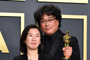 "Producer Kwak Sin-ae and director Bong Joon-ho, winners of the Original Screenplay, International Feature Film, Directing, and Best Picture awards for ""Parasite,"" pose in the press room during the 92nd Annual Academy Awards at Hollywood and Highland on February 09, 2020 in Hollywood, California."