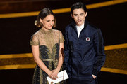 (L-R) Natalie Portman and Timothée Chalamet speak onstage during the 92nd Annual Academy Awards at Dolby Theatre on February 09, 2020 in Hollywood, California.