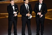 (L-R) Greg Butler, Guillaume Rocheron, and Dominic Tuohy accept the Visual Effects award for '1917' onstage during the 92nd Annual Academy Awards at Dolby Theatre on February 09, 2020 in Hollywood, California.