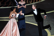 (L-R) Regina King presents the Actor in a Supporting Role award for 'Once Upon a Time...in Hollywood' to Brad Pitt onstage during the 92nd Annual Academy Awards at Dolby Theatre on February 09, 2020 in Hollywood, California.