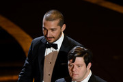 (L-R) Shia LaBeouf and Zack Gottsagen speak onstage during the 92nd Annual Academy Awards at Dolby Theatre on February 09, 2020 in Hollywood, California.