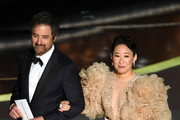 (L-R) Ray Romano and Sandra Oh walk onstage during the 92nd Annual Academy Awards at Dolby Theatre on February 09, 2020 in Hollywood, California.