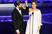 (L-R) Oscar Isaac and Salma Hayek Pinault speak onstage during the 92nd Annual Academy Awards at Dolby Theatre on February 09, 2020 in Hollywood, California.