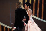 (L-R) Brad Pitt, winner of thethe Actor in a Supporting Role award for 'Once Upon a Time...in Hollywood,' and Regina King walk onstage during the 92nd Annual Academy Awards at Dolby Theatre on February 09, 2020 in Hollywood, California.