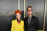 (L-R) Sandy Powell and Christopher Peterson attend the 92nd Oscars Nominees Luncheon on January 27, 2020 in Hollywood, California.