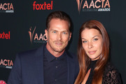 (L-R) Jason Lewis and Liz Godwin attend the 9th AACTA International Awards at Mondrian Los Angeles on January 03, 2020 in West Hollywood, California.