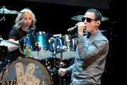 Musicians Eric Kretz (L) and Chester Bennington perform at the 9th Annual MusiCares MAP Fund Benefit Concert at Club Nokia on May 30, 2013 in Los Angeles, California.