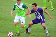 Ufuk Talay of the Fury contests the ball with Jacob Burns of the Glory during the match between the North Queensland Fury and the Perth Glory at Dairy Farmers Stadium on November 28, 2010 in Townsville, Australia.