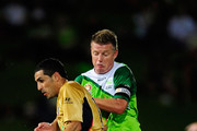 Ufuk Talay of the Fury tackles Ali Abbas of the Jets during the round 17 A-League match between the North Queensland Fury and the Newcastle Jets at Dairy Farmers Stadium on December 4, 2010 in Townsville, Australia.