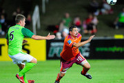 Charlie Miller of the Roar and Ufuk Talay of the Fury  chase the ball during the round five A-League match between the North Queensland Fury and the Brisbane Roar at Dairy Farmers Stadium on September 5, 2009 in Townsville, Australia.