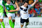 Ufuk Talay of the Fury tackles Billy Celeski of the Victory during the round seven A-League match between the North Queensland Fury and the Melbourne Victory at Dairy Farmers Stadium on September 18, 2010 in Townsville, Australia.