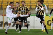 Nick Ward of the Phoenix deflects a kick at goal by Ufuk Talay of the Fury during the round eight A-League match between the Wellington Phoenix and the North Queensland Fury at Westpac Stadium on September 24, 2010 in Wellington, New Zealand.
