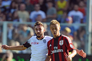 Keisuke Honda # 10 of AC Milan ( R ) competes the ball with Francesco Renzetti # 33 of AC Cesena ( L ) during the Serie A match between AC Cesena and AC Milan at Dino Manuzzi Stadium on September 28, 2014 in Cesena, Italy.