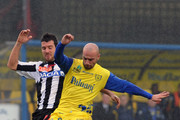 Roberto Guana (R) of Chievo competes with Andrea Lazzari of Udinese during the Serie A match between AC Chievo Verona and Udinese Calcio at Stadio Marc'Antonio Bentegodi on November 11, 2012 in Verona, Italy.