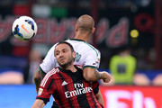Giampaolo Pazzini of AC Milan and Paolo Cannavaro of US Sassuolo Calcio (R) during the Serie A match between AC Milan and US Sassuolo Calcio at San Siro Stadium on May 18, 2014 in Milan, Italy.