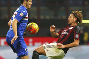 Alessio Cerci (R) of AC Milan competes with Djamel Mesbah (L) of UC Sampdoria during the Serie A match between AC Milan and UC Sampdoria at Stadio Giuseppe Meazza on November 28, 2015 in Milan, Italy.