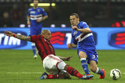 Djamel Mesbah (R) of UC Sampdoria is challenged by Nigel De Jong (L) of AC Milan during the Serie A match between AC Milan and UC Sampdoria  at Stadio Giuseppe Meazza on April 12, 2015 in Milan, Italy.