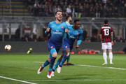 Aaron Ramsey of Arsenal celebrates after scoring during the UEFA Europa League Round of 16 match between AC Milan and Arsenal at the San Siro on March 8, 2018 in Milan, Italy.