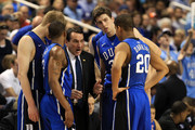 Head coach Mike Krzyzewski of the Duke Blue Devils talks with players Kyle Singler #12, Nolan Smith #2, Mason Plumlee #5, Ryan Kelly #34 and Andre Dawkins #20 during the first half of the game against the North Carolina Tar Heels in the championship game of the 2011 ACC men's basketball tournament at the Greensboro Coliseum on March 13, 2011 in Greensboro, North Carolina.