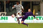 Patrice Evra of Juventus FC in action against Federico Bernardeschi of ACF Fiorentina during the Serie A match between ACF Fiorentina and Juventus FC at Stadio Artemio Franchi on April 24, 2016 in Florence, Italy.