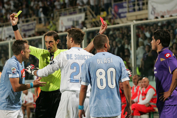 Referee Andrea Gervasoni shows the yellow card to Hugo Campagnaro of SSC Napoli (L) and the red to Juan Manuel Vargas of ACF Fiorentina  during the Serie A match between Fiorentina and Napoli at Stadio Artemio Franchi on August 29, 2010 in Florence, Italy.