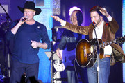 Tracy Lawrence and Carlton Anderson perform onstage at ACM Lifting Lives®: Decades on April 06, 2019 in Las Vegas, Nevada.