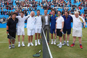 (L-R) Michael McIntyre, Eddie Redmayne, Sir Richard Branson, Tim Henman, Ross Hutchins, Andy Murray, Jimmy Carr, Jonathan Ross and London Mayor Boris Johnson pose during the Rally Against Cancer charity match on day seven of the AEGON Championships at Queens Club on June 16, 2013 in London, England.