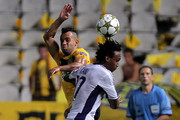 Edmar of AEL Limassol (L) challenges Kanu of RSC Anderlecht  during the UEFA Champions League first leg play-off between AEL Limassol and RSC Anderlecht  at the GSP Stadium on August 22, 2012 in Nicosia,Cyprus.