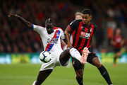 Mamadou Sakho of Crystal Palace battles for possession with Joshua King of AFC Bournemouth during the Premier League match between AFC Bournemouth and Crystal Palace at Vitality Stadium on October 1, 2018 in Bournemouth, United Kingdom.