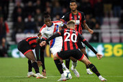 Wilfried Zaha of Crystal Palace controls the ball as David Brooks of AFC Bournemouth and teammates look on during the Premier League match between AFC Bournemouth and Crystal Palace at Vitality Stadium on October 1, 2018 in Bournemouth, United Kingdom.