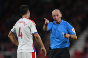 Refeeree Mike Dean talks to Luka Milivojevic of Crystal Palace during the Premier League match between AFC Bournemouth and Crystal Palace at Vitality Stadium on October 1, 2018 in Bournemouth, United Kingdom.