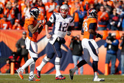 Tom Brady #12 of the New England Patriots runs off the field in the first quarter against the Denver Broncos in the AFC Championship game at Sports Authority Field at Mile High on January 24, 2016 in Denver, Colorado.
