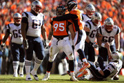 Derek Wolfe #95 of the Denver Broncos celebrates with  Von Miller #58 after a sack on Tom Brady #12 of the New England Patriots in the first quarter in the AFC Championship game at Sports Authority Field at Mile High on January 24, 2016 in Denver, Colorado.