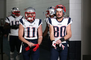 Julian Edelman #11 and Danny Amendola #80 of the New England Patriots take the field prior to the AFC Championship game against the Denver Broncos at Sports Authority Field at Mile High on January 24, 2016 in Denver, Colorado.