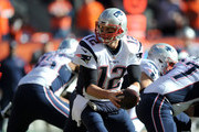 Tom Brady #12 of the New England Patriots looks to hand the ball off in the first quarter against the Denver Broncos in the AFC Championship game at Sports Authority Field at Mile High on January 24, 2016 in Denver, Colorado.