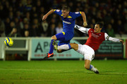 Charlie Strutton of AFC Wimbledon is challenged by Chris Smith of York City during the FA Cup First Round Replay between AFC Wimbledon and York City at The Cherry Red Records Stadium on November 12, 2012 in Kingston upon Thames, England.