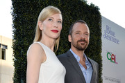 Actors Cate Blanchett and Peter Sarsgaard arrive at the premiere of 'Blue Jasmine' hosted by AFI & Sony Picture Classics at AMPAS Samuel Goldwyn Theater on July 24, 2013 in Beverly Hills, California.