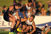 Brad Sheppard of the Eagles tackles Hayden Ballantyne of the Dockers during the round two NAB Challenge Cup AFL match between the Fremantle Dockers and the West Coast Eagles at Arena Joondalup on February 18, 2014 in Perth, Australia.