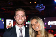 Tom Mitchell of the Hawks poses with his partner Hannah Davis and theÊLeigh Matthews Trophy, the award presented to the Most Valuable Player of the season during the 2018 AFL Players' MVP Awards at the Basement on August 30, 2018 in Melbourne, Australia.