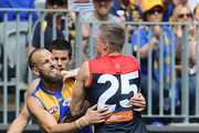 Will Schofield of the Eagles and Tom McDonald of the Demons wrestle during the AFL Prelimary Final match between the West Coast Eagles and the Melbourne Demons on September 22, 2018 in Perth, Australia.