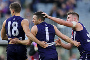 Hayden Ballantyne of the Dockers celebrates a goal with Darcy Tucker and Luke Ryan during the round 12 AFL match between the Fremantle Dockers and the Adelaide Crows at Optus Stadium on June 10, 2018 in Perth, Australia.