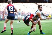 Jeremy Howe of the Magpies withstands a tackle from Charlie Spargo of the Demons during the round 12 AFL match between the Melbourne Demons and the Collingwood Magpies at Melbourne Cricket Ground on June 11, 2018 in Melbourne, Australia.