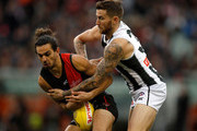 Jake Long of the Bombers and Jeremy Howe of the Magpies during the 2018 AFL round 16 match between the Essendon Bombers and the Collingwood Magpies at the Melbourne Cricket Ground on July 08, 2018 in Melbourne, Australia.
