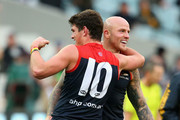 Nathan Jones and Angus Brayshaw of the Demons  celebrate winning the round 18 AFL match between the Collingwood Magpies and the Melbourne Demons at Melbourne Cricket Ground on August 1, 2015 in Melbourne, Australia.