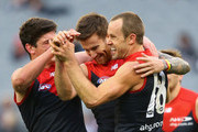 Jeremy Howe of the Demons is congratulated by Angus Brayshaw and Daniel Cross after kicking a goal during the round 18 AFL match between the Collingwood Magpies and the Melbourne Demons at Melbourne Cricket Ground on August 1, 2015 in Melbourne, Australia.