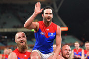Jordan Lewis of the Demons is chaired from the field by Max Gawn of the Demons and Nathan Jones of the Demons after his 300th AFL game during the round 19 AFL match between the Adelaide Crows and the Melbourne Demons at Adelaide Oval on July 28, 2018 in Adelaide, Australia.