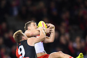 Tom Papley of the Swans marks infront of Brendon Goddard of the Bombers during the round 19 AFL match between the Essendon Bombers and the Sydney Swans at Etihad Stadium on July 27, 2018 in Melbourne, Australia.