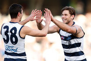 Tom Hawkins of the Cats (right) celebrates a goal with Jack Henry of the Cats during the 2018 AFL round 19 match between the Geelong Cats and the Brisbane Lions at GMHBA Stadium on July 28, 2018 in Geelong, Australia.