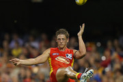 Daniel Harris of the Suns kicks during the round two AFL match between the Gold Coast Suns and the Carlton Blues at The Gabba on April 2, 2011 in Brisbane, Australia.