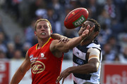 Daniel Harris of the Suns and Travis Varcoe of the Cats contest for the ball during the round 20 AFL match between the Geelong Cats and the Gold Coast Suns at Skilled Stadium on August 6, 2011 in Geelong, Australia.